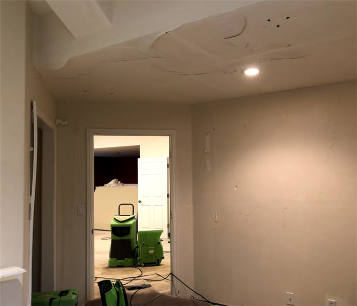 a white ceiling with paint peeling off