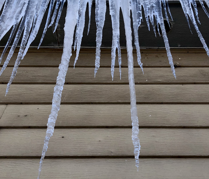 icicles hanging from gutters of a home