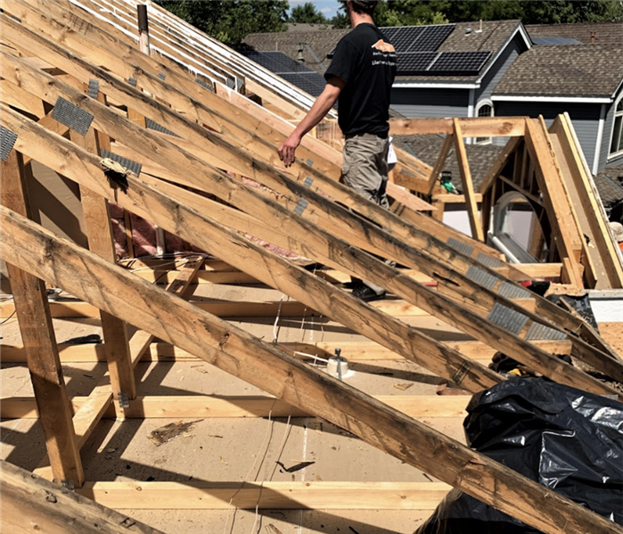 a roof in mid construction with the framing done
