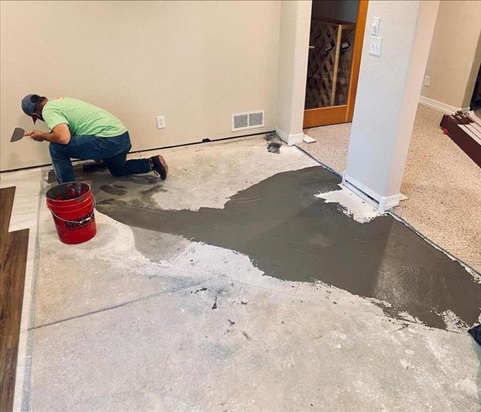 Team member working on floors.