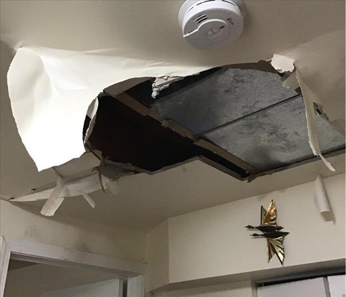 Ceiling damage following a water leak.