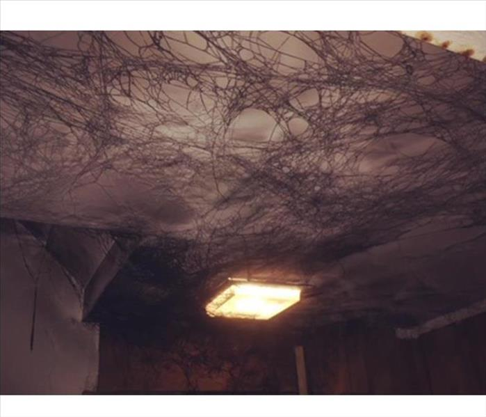 Soot webs on ceiling. Puff back
