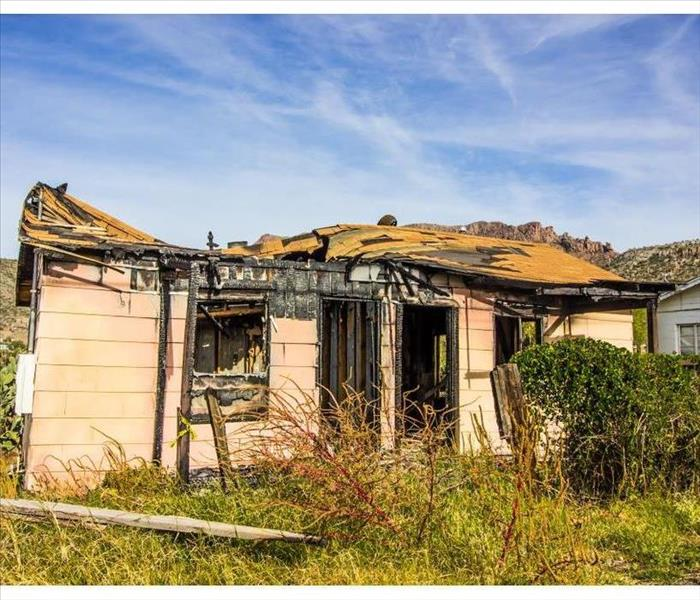 Home destroyed by fire with caved on roof