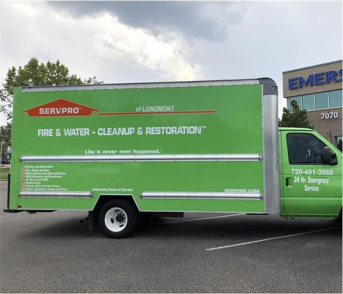 Green SERVPRO truck parked in a parking lot